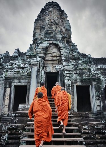 Buddhistic Monks enter Bayon grey